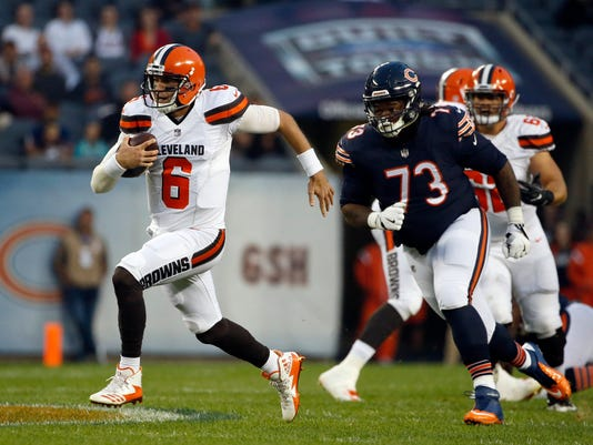 Cleveland Browns quarterback Cody Kessler (6) runs against Chicago Bears defensive tackle John Jenkins (73) during the first half of an NFL football game, Thursday, Aug. 31, 2017, in Chicago. (AP Photo/Nam Y. Huh)