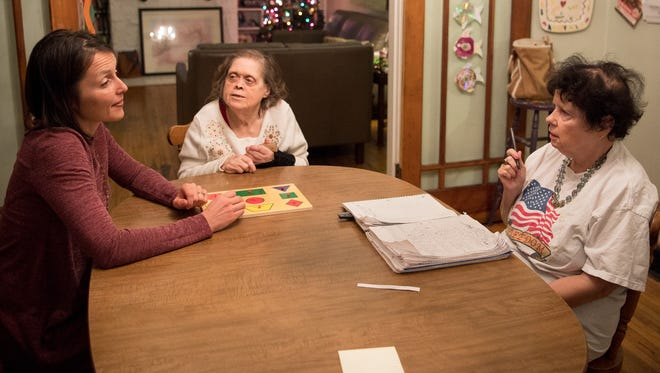 Volunteer Jenny Gustafson, left, chats with Ruby Truette, center, and Jennifer Pettit, at their home in Nashville on Wednesday, Dec. 13, 2017.