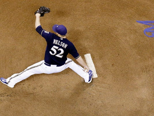 Milwaukee Brewers starting pitcher Jimmy Nelson throws during the first inning of a baseball game against the Chicago Cubs, Friday, Sept. 26, 2014, in Milwaukee. (AP Photo/Morry Gash)