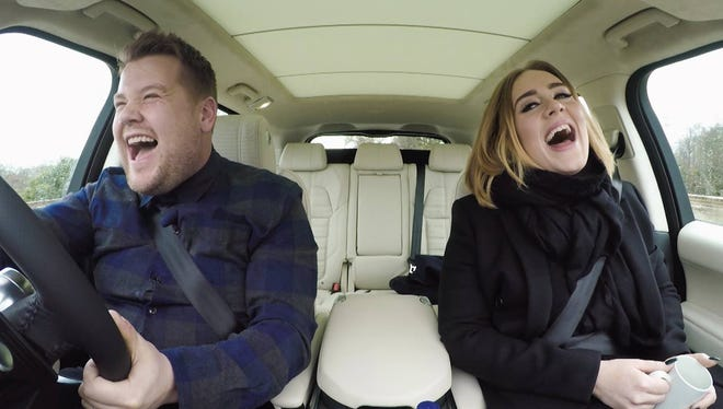 """James Corden, left, and Adele sing on his """"Late Late Show."""""""