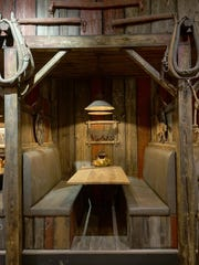 Grindstone Smokehouse owner James Raptoplous did much of the construction remodeling the restaurant, like this booth, himself.