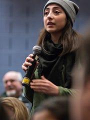 Student Nour Kazbour questions the panel.