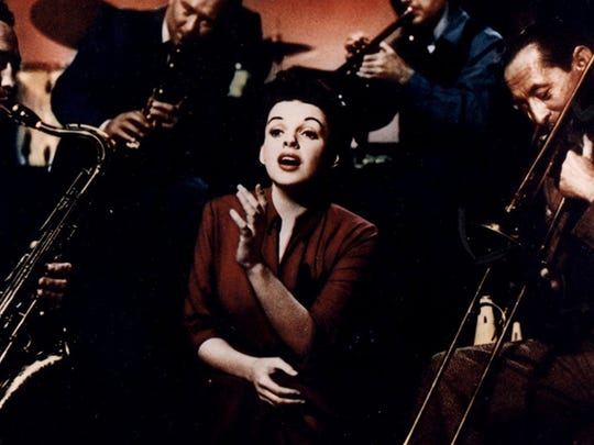 "Judy Garland sings after hours in a scene from the 1954 ""A Star Is Born."""