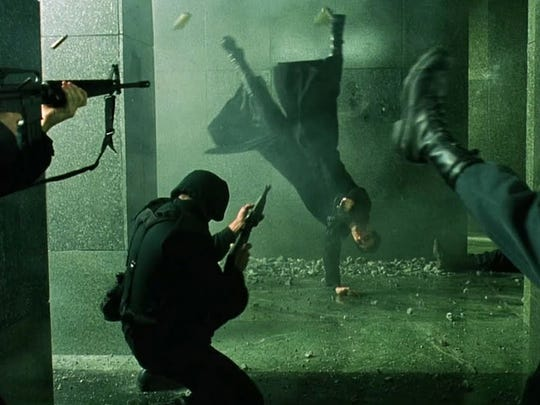 "Neo (Keanu Reeves) and Trinity (Carrie-Anne Moss) show skills trying to save Morpheus (Laurence Fishburne) in ""The Matrix."""