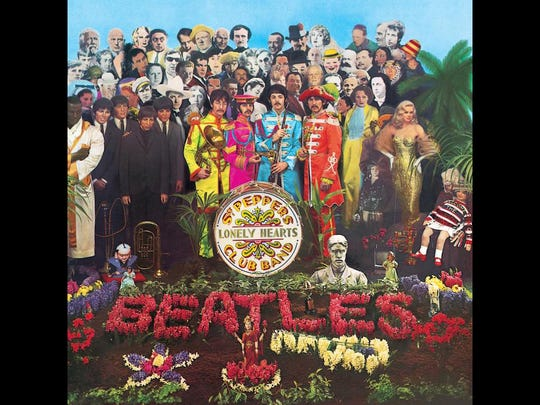 "The Beatles, backed by dozens of celebrities, on the cover of ""Sgt. Pepper."""