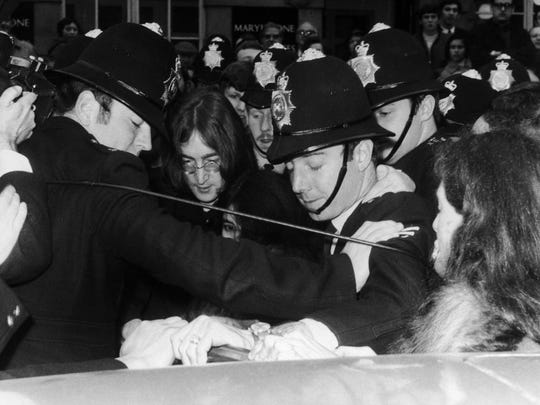 Pretty little policemen in a row, busting John Lennon.