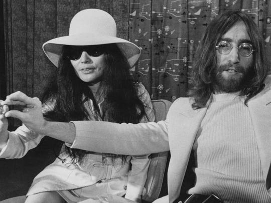 Yoko Ono and John Lennon, in sync in all-white.