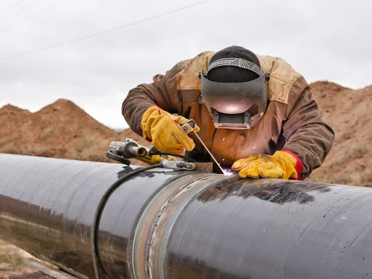 welding-works-on-gas-pipeline-oil-and-gas-pipeline-construction.jpg