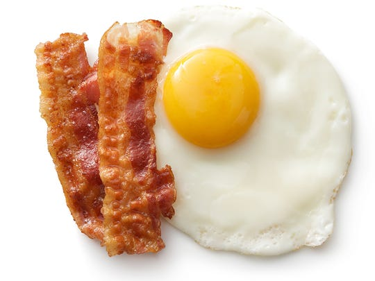 """The bacon fad may or may not be abating somewhat, but there's no disputing that we're eating more of it than ever. Bacon consumption levels were at historical highs last year, according to The National Provisioner, a food business trade publication. Bacon has been appearing in all menu categories — even desserts and beverages, both of which saw a 17% rise in bacon use over 2016.   Bacon has long been an essential part of the American diet, at least for carnivores, even before people started putting it in candy canes, coffee, soda, and other places it probably doesn't belong. It can attract non-carnivores, too: Bacon has been called the ultimate """"conversion food"""" because it tempts even the most ardent vegetarians.   Bacon prices have risen and fallen substantially over the years. According to the U.S. Bureau of Labor Statistics, the average price of a pound of sliced bacon has more than doubled over just the past two decades from $2.64 in January of 1998 to $5.42 in July of this year. Along the way, though, it hit even higher marks, reaching $6.37 in September of 2017 — and the price has been trending downward since that peak.   Price swings for bacon are so notable that for 50 years, pork bellies — the meat American bacon is made from — were traded as a commodity on the Chicago Mercantile Exchange, with frozen bellies stockpiled as a hedge against rising seasonal pork prices. (The trade was halted in 2011 as seasonal demand for the meat evened out.)   While it may appear in many guises today, bacon is inextricably linked above all to another form of protein: the egg. Bacon and eggs is as emblematic a food combination as salt and pepper, chips and salsa, or burgers and fries."""