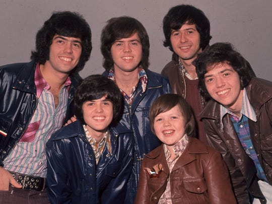 The Osmonds in their heyday, with Jimmy seated in front to the right of Donny.