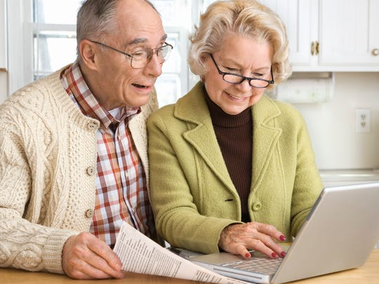 senior-couple-working-on-laptop.jpg