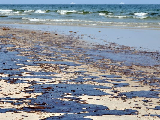 oil-spill-on-beach-bp1-e1462994697504.jpg