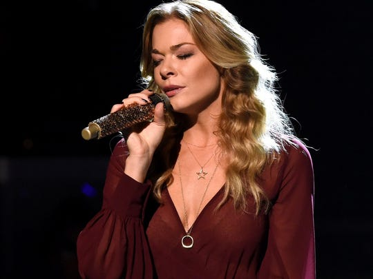 "LeAnn Rimes is receiving criticism, but also much support, after an Instagram post that showed her getting a tattoo that says ""god's work."" Some told Rimes ""God"" should be capitalized."