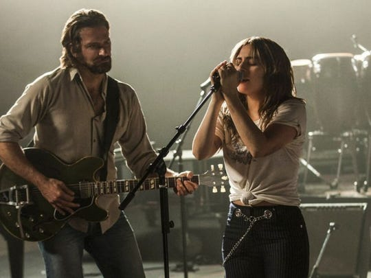 "Bradley Cooper and Lady Gaga perform in ""A Star is Born."""