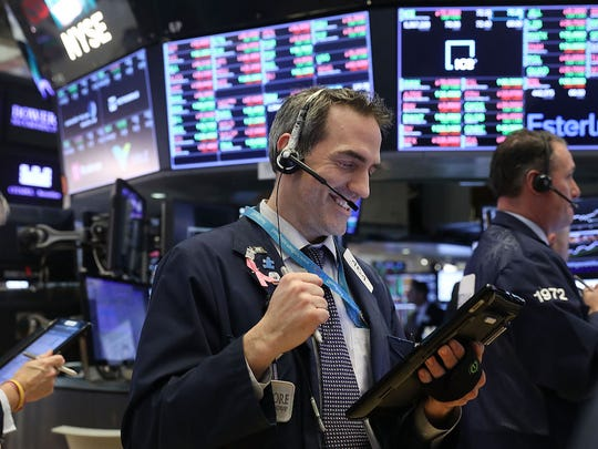 Stocks moved higher Monday morning on tech, banking shares.