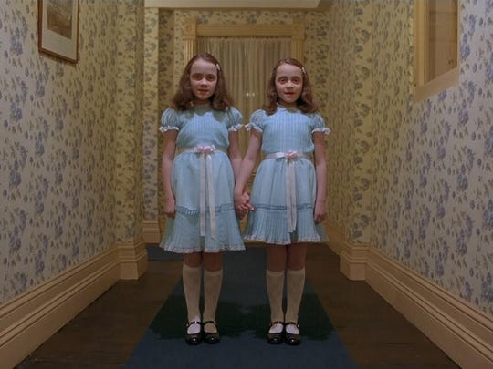 "In an iconic scene from the 1980 horror classic ""The Shining,"" twins make an ominous appearance down a narrow hallway."