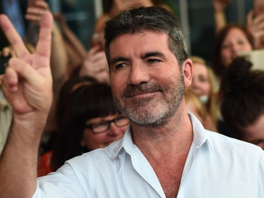 Simon Cowell is recovering from breaking his back when he was hit by an electric bicycle.