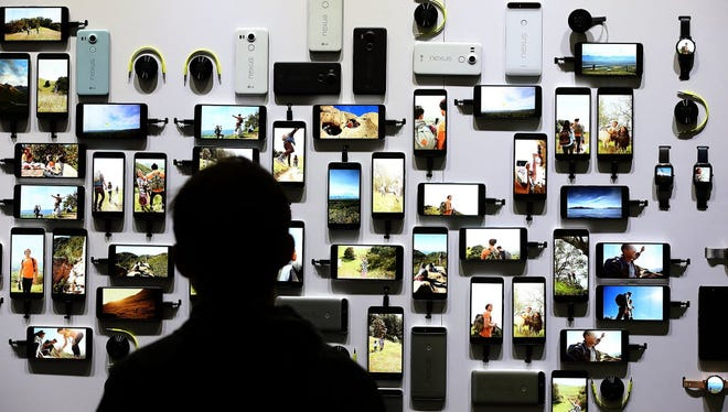 An attendee looks at a display of new Google devices during a Google media event on September 29, 2015 in San Francisco, Calif.