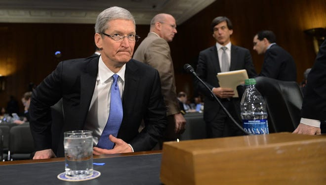 Shawn Thew, EPA Apple CEO Tim Cook is shown in 2013. Apple said it doesn?t want to create a ?GovtOS.? Apple CEO Tim Cook, shown here testifying in Congress in 2013, is battling the FBI over its request for a back door to a killer's iPhone.