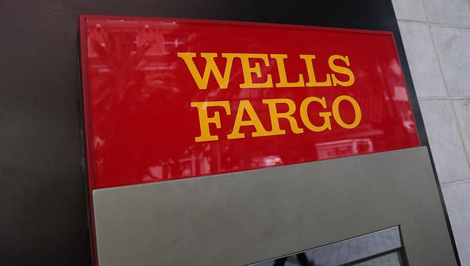 A sign is seen on a Wells Fargo ATM at one of their bank branches on September 9, 2016 in Miami, Florida.