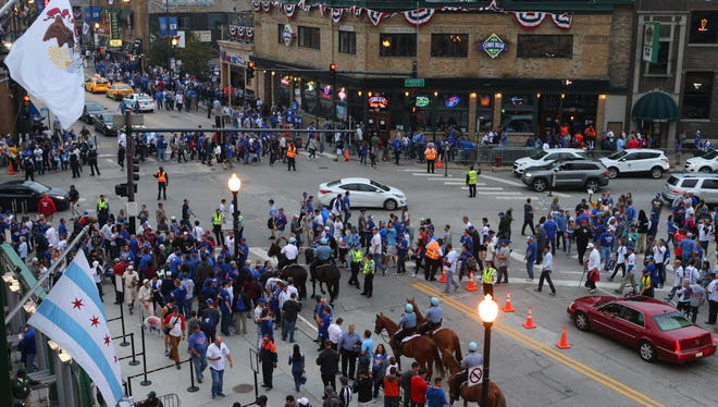 Fans cross the street at Clark and Addison in Wrigleyville before game two of the 2016 NLCS playoff baseball series between the Chicago Cubs and Los Angeles Dodgers at Wrigley Field.