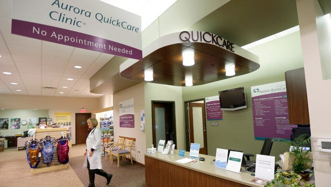 Kelly Quandt, a nurse practitioner, walks to greet a patient at Aurora QuickCare Clinic at 10932 N Port Washington Rd. in Mequon. Aurora is closing its remaining QuickCare clinics and taking over the clinics now in Walgreens stores.