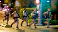Police tactics experts said they understood the officer hesitating as he led a trainee and three security guards toward the sound of rapid gunfire.