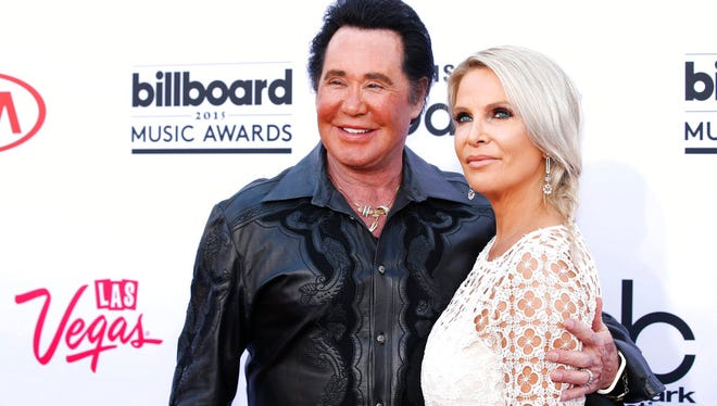 In this May 17, 2015 file photo, Wayne Newton, left, and his wife Kathleen McCrone arrive at the Billboard Music Awards at the MGM Grand Garden Arena in Las Vegas.