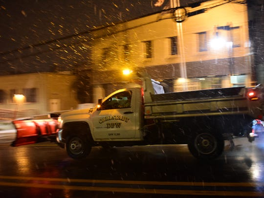 A Carlstadt DPW salting and plow truck rolls along Hackensack St in the early morning hours spreading salt to the roadway Thursday, Feb. 9, 2017