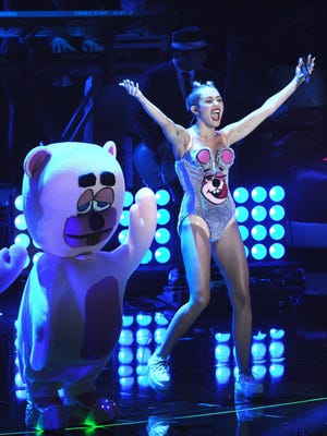 Miley Cyrus performs at the MTV Video Music Awards at the Barclays Center in Brooklyn, N.Y., in 2013.