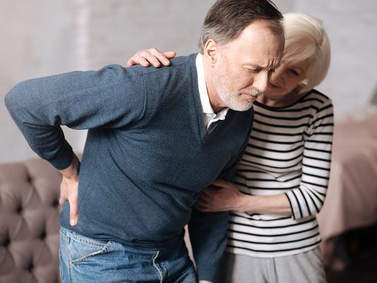Senior man with terrible backache near wife