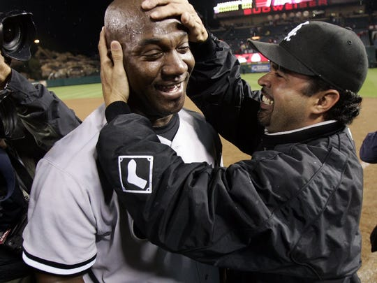 Chicago White Sox pitcher Jose Contreras, left, is congratulated by manager Ozzie Guillen after the White Sox beat the Los Angeles Angels, 6-3, in Game 5 of the American League Championship Series, Sunday, Oct. 16, 2005, in Anaheim, Calif. The White Sox advance to the World Series.