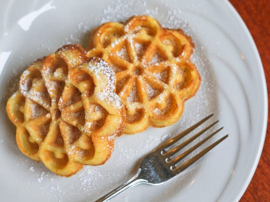Verbena Cafe's mini Belgian waffles are dusted with powdered sugar. Jan. 26, 2016