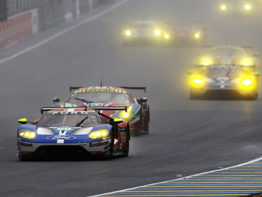 The Chip Ganassi Racing Team Ford GT of Ryan Briscoe, Scott Dixon and Richard Westbrook leads a pack of cars at the start of the Le Mans 24 Hour race at the Circuit de la Sarthe on June 18, 2016 in Le Mans, France.