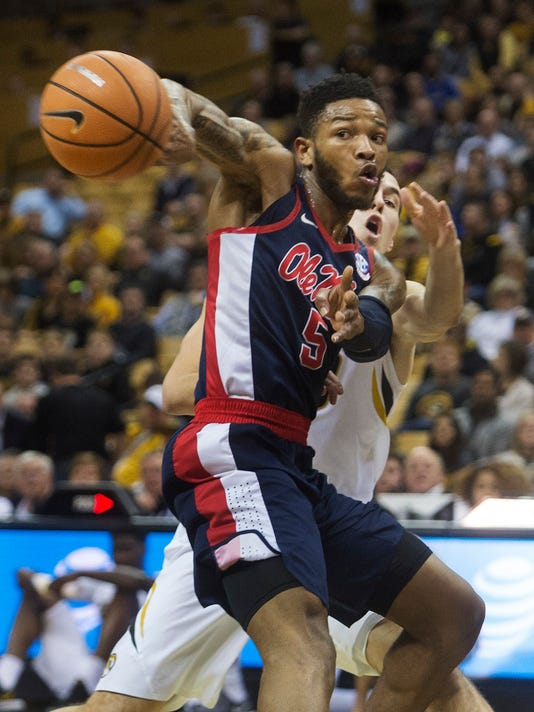 Mississippi's Markel Crawford, left, passes the ball in front of Missouri's Cullen VanLeer during the first half of an NCAA college basketball game Tuesday, Feb. 20, 2018, in Columbia, Mo. (AP Photo/L.G. Patterson)