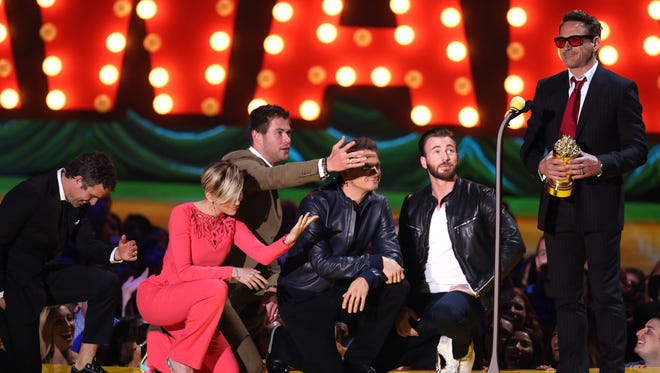 Mark Ruffalo, from left, Scarlett Johansson, Chris Hemsworth, Jeremy Renner and Chris Evans present Robert Downey Jr. with the generation award at the MTV Movie Awards at the Nokia Theatre on April 12, 2015, in Los Angeles.