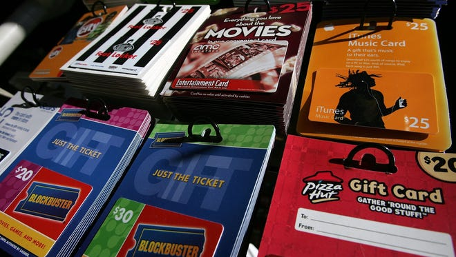 Gift cards from various retailers are seen on display.