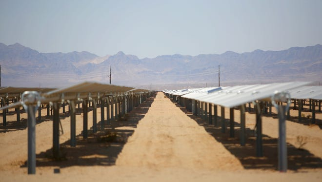 Solar panels soak up the sun at the 250-megawatt McCoy solar project on federal land near Blythe, California on June 22, 2016.