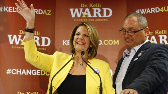 Senate candidate Kelli Ward, with her husband, Mike, at her side, concedes to Sen. John McCain during her primary election night party at the Scottsdale DoubleTree Resort on Tuesday, Aug. 30, 2016, in Scottsdale.