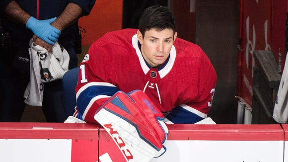 Montreal Canadiens goaltender Carey Price watches from the bench during the second period of the team's NHL hockey game against the Edmonton Oilers on Saturday, Dec. 9, 2017, in Montreal. (Graham Hughes/The Canadian Press via AP)