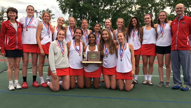 The Champlain Valley girls tennis team poses with the state championship trophy after its 7-0 win over South Burlington on Thursday in Shelburne.