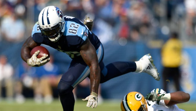 Titans tight end Delanie Walker (82) gets away from Packers defensive back Kentrell Brice (29) in the first half  at Nissan Stadium Sunday, Nov. 13, 2016, in Nashville, Tenn.