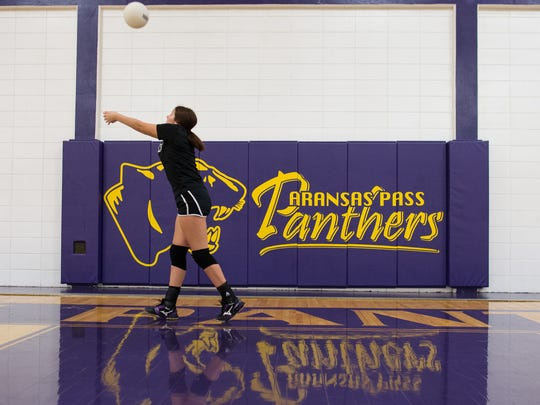 Aransas Pass volleyball players run drills as they warm up during practice in their gym at Aransas Pass High School on Thursday, Sept. 14, 2017.