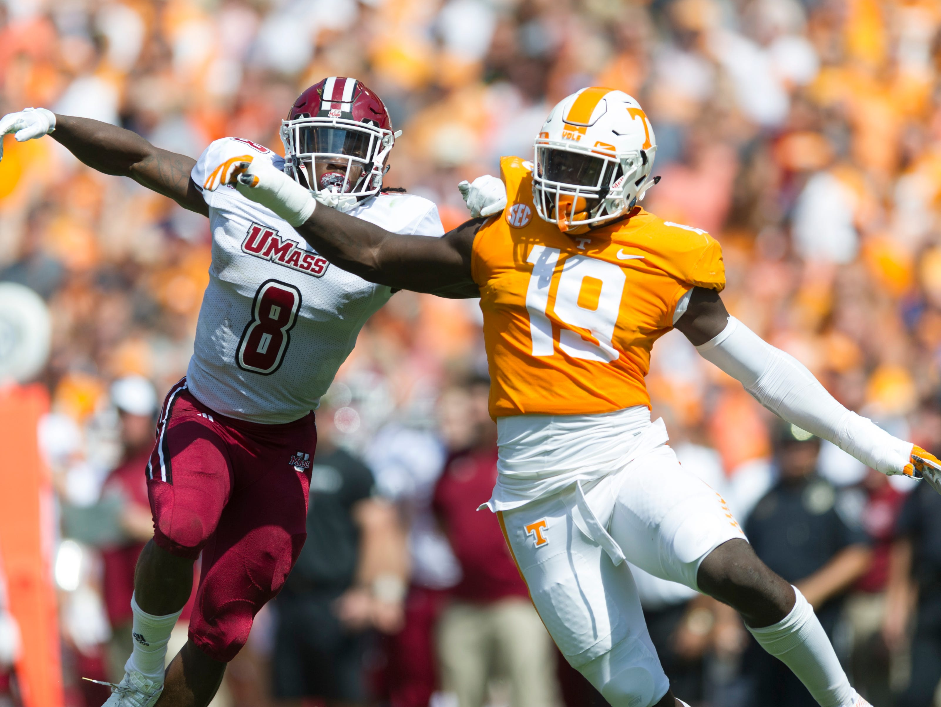 Vols defensive lineman Darrell Taylor (19) and UMass linebacker Shane Huber (8) bump against each other during the game Sept. 23, 2017.