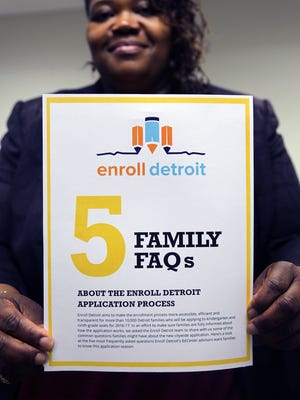 Bernita Bradley, the Outreach and Community Engagement manager holds a flier that helps answer five questions about the new Enroll Detroit Center located in the Northwest Activities Center.