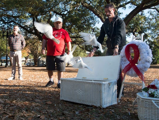 Danny Holt observes a previous World AIDS Day with the release of white doves to remember those who have died from the disease. An event for this year's observance is set for noon to 4 p.m. at Brent Raiders Football Field, 501 Yoakum Court.