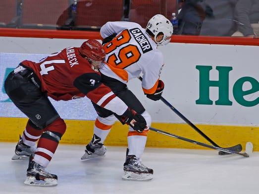 Coyotes' Klas Dahlbeck (34) defends Flyers' Sam Gagner