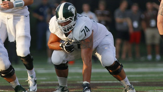 Michigan State offensive lineman Jack Conklin prepares to block against Western Michigan on Sept. 4, 2015, in Kalamazoo.