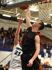 Northville's Jake Justice traps and blocks the shot