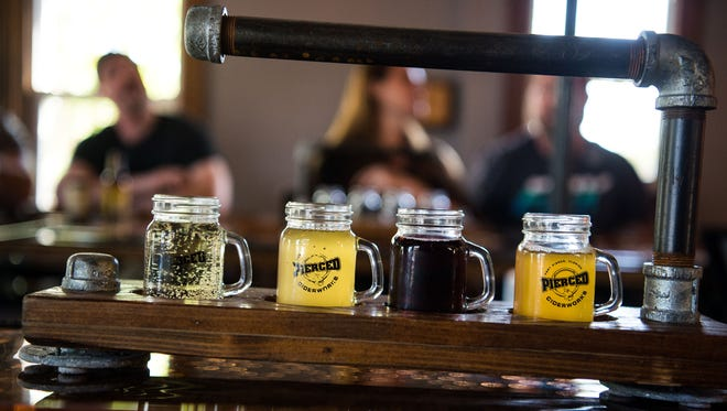 A flight of ciders at Pierced Ciderworks sits on the bar Wednesday, March 28, 2018, at 411 N. Second St. in Fort Pierce. House-made ciders (from right) Pierced Dry, Pierced Blackberry and Pierced Coconut sit alongside a popular California cider, Ace Pineapple.